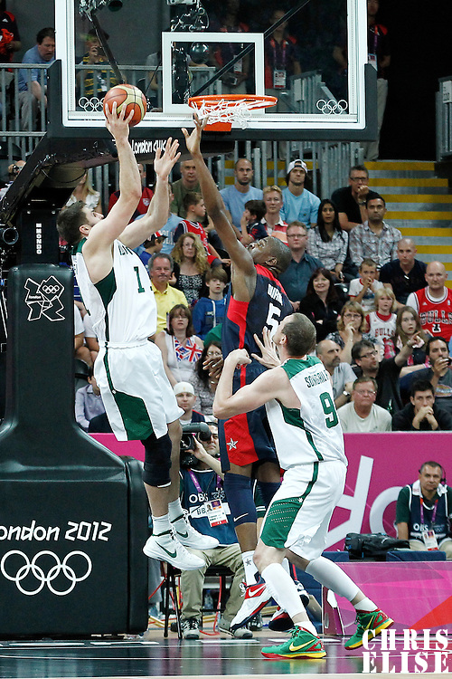 04 August 2012: Lithuania Linas Kleiza goes for the layup over Kevin Durant during 99-94 Team USA victory over Team Lithuania, during the men's basketball preliminary, at the Basketball Arena, in London, Great Britain.
