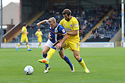 AFC Wimbledon defender Jon Meades (3) plays his first game this season, is challenged by Rochdale FC midfielder Jamie Allen (24) during the EFL Sky Bet League 1 match between Rochdale and AFC Wimbledon at Spotland, Rochdale, England on 27 August 2016. Photo by Stuart Butcher.