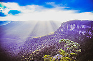 Rays of sunlight spread out over the Blue Mountains in Australia.