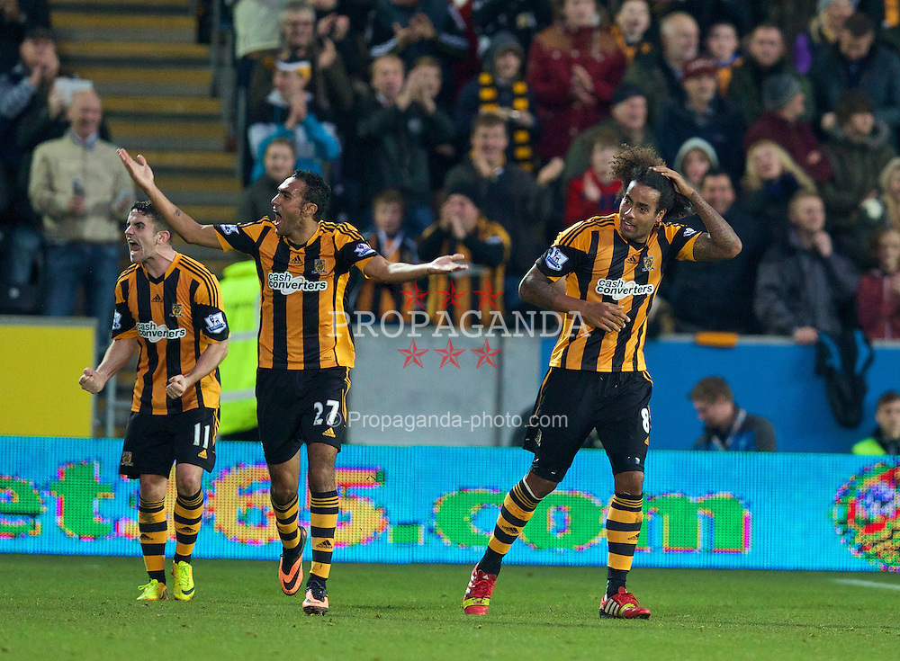HULL, ENGLAND - Sunday, December 1, 2013: Hull City's Tom Huddlestone celebrates scoring the third goal against Liverpool during the Premiership match at the KC Stadium. (Pic by David Rawcliffe/Propaganda)