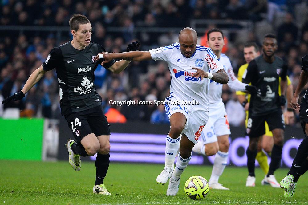 Gaetan BUSSMANN / Andre AYEW - 07.12.2014 - Marseille / Metz - 17eme journee de Ligue 1 -<br />Photo : Gaston Petrelli / Icon Sport
