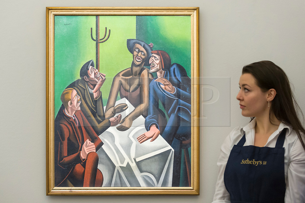"""© Licensed to London News Pictures. 16/11/2018. LONDON, UK. A technician views """"The Joke"""", 1923, by William Roberts (Est. GBP300,000-500,000). Preview of Sotheby's autumn sale of Modern & Post War British art.  Works from the British art scene of the past century will be offered for sale on 20 and 21 November 2018 at Sotheby's in London.  Photo credit: Stephen Chung/LNP"""