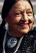 THIS PHOTO IS AVAILABLE FOR WEB DOWNLOAD ONLY. PLEASE CONTACT US FOR A LARGER PHOTO. Native American older woman with black and silver beaded necklace.  MR