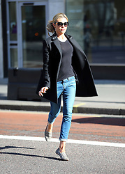 Model Abbey Clancy out wearing a black coat, see-through top, jeans and pumps makes a dash to the cashpoint before going shopping at SelfrIdges in high heels. London, UK. 24/02/2014<br /> BYLINE MUST READ : JAMESY/GOTCHA IMAGES<br /> <br /> Copyright by © Gotcha Images Ltd. All rights reserved.<br /> Usage of this image is conditional upon the acceptance <br /> of Gotcha Images Ltd, terms and conditions available at<br /> www.gotchaimages.com