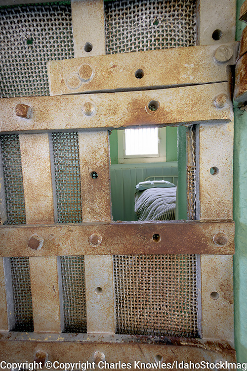 View of a prison cell through the bars, Old Idaho State Penitentiary.