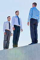 Businessman standing in office rooftop