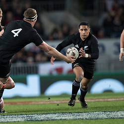 Brodie Retallick offloads Aaron Smith during game 7 of the British and Irish Lions 2017 Tour of New Zealand, the first Test match between  The All Blacks and British and Irish Lions, Eden Park, Auckland, Saturday 24th June 2017<br /> (Photo by Kevin Booth Steve Haag Sports)<br /> <br /> Images for social media must have consent from Steve Haag