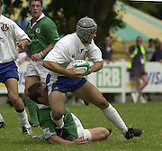 © Peter Spurrier / Intersport images.email images@intersport-images.com.29/6/03 Photo Peter Spurrier.IRB U21 Rugby World Cup - Henley - Oxon.Ireland v Italy.Alessandro Chillon, looks for support.