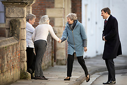 © Licensed to London News Pictures. 04/03/2019. Salisbury, UK. Local residents greet Prime Minister Theresa May as she visits Salisbury with local MP John Glen (R) on the first anniversary of the poisoning of former Russian spy Sergei Skripal and his daughter Yulia in March 2018. They both survived the nerve agent attack but a resident of nearby Amesbury, Dawn Sturgess, died in June 2018 after coming in contact with the poison. Two Russians have been named in connection with the attack. Photo credit: Peter Macdiarmid/LNP