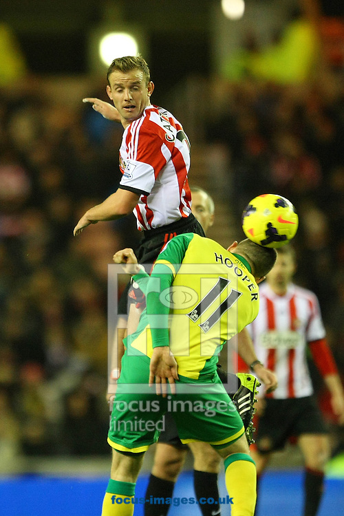 Picture by Paul Chesterton/Focus Images Ltd +44 7904 640267<br /> 21/12/2013<br /> Sunderland's Lee Cattermole and Bradley Johnson of Norwich in action during the Barclays Premier League match at the Stadium Of Light, Sunderland.