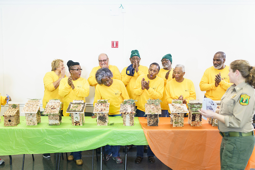 Upper Marlboro, Maryland - January 03, 2017: Members of the Senior Green Team react after Park Ranger Amanda Abrams announces the winners of the birdhouse decorating competition at the Watkins Park Nature Center in Upper Marlboro, Md., Tuesday January 3, 2017. Three judges will decide the group's top birdhouses. The group meets the first Tuesday morning of each month and works on nature beautification projects like trail maintenance, tree planting, clean ups, and, educational outings. <br /> <br /> CREDIT: Matt Roth