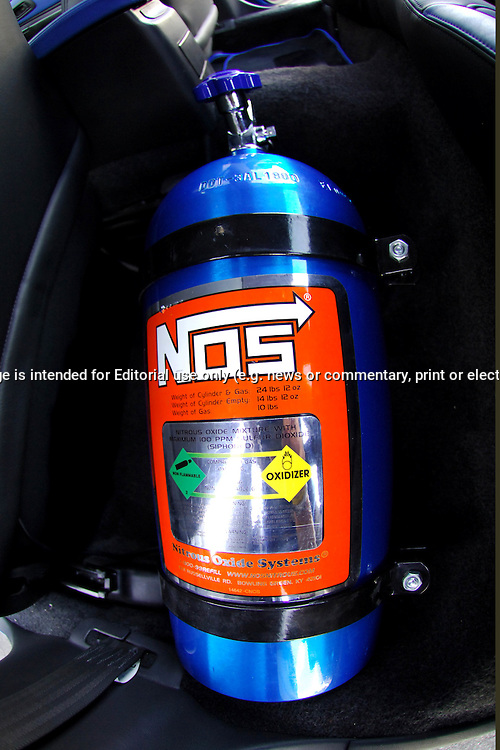 Nitrous Oxide Systems (NOS) bottle inside car Interior .2000 MY00 Subaru Impreza WRX - WR Blue.Shot on location in Thomastown.10th December 2005.(C) Joel Strickland Photographics.Use information: This image is intended for Editorial use only (e.g. news or commentary, print or electronic). Any commercial or promotional use requires additional clearance.