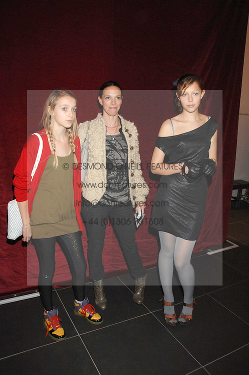 Left to right, AGATHE CHAPMAN, her mother TIPHAINE CHAPMAN wife of artist Dinos Chapman and SERAPHINE CHAPMAN at a party to celebrate the opening of the new H&amp;M store at 234 Regent Street, London on 13th February 2008.<br />