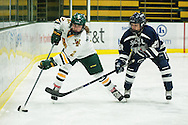 Vermont's Kourtney Menches (2) skates past New Hampshire's Marie-Jo Pelletier (21) with the puck during the women's hockey game between the New Hampshire Wildcats and the Vermont Catamounts at Gutterson Field House on Friday night February 3, 2017 in Burlington. (BRIAN JENKINS/for the FREE PRESS)