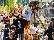 15 JULY 2016 - GIANYAR, UBUD, BALI, INDONESIA:  Men light the flame under the sarcophagus during the community wide cremation in Gianyar. Most of the people on Bali are Hindus. Traditional cremations in Bali are very expensive, so communities usually hold one mass cremation approximately every five years. Most of the mass cremations in Bali are held in late June or early July. Gianyar, a small village about 30 minutes from Ubud, held their village wide cremation Friday. The community wide mass cremation in Ubud is Saturday.       PHOTO BY JACK KURTZ