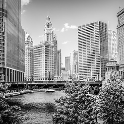 Chicago at Wabash Bridge black and white picture. High resolution photo includes the Chicago River, Trump Tower, Wrigley Building, and the Equitable Building. Picture was taken in 2012.