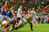 Thomas Burgess of England tackled by Bastien Escamilla and Stanislas Robin of France during the International Friendly match at Leigh Sports Village, Leigh<br /> Picture by Steve McCormick/Focus Images Ltd 07545 862647<br /> 17/10/2018