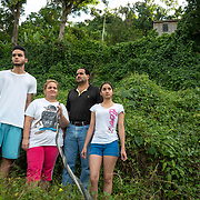 JULY 19, 2018----UTUADO, PUERTO RICO---<br /> From left;  Byron Joxel Ruiz, 14, Mum - Diana Ivelisse Vera Maldonado, 44,  Jose Ruiz Gonzalez, 45, and  Ledianne Ruiz-Vera, 20, in front of their house with the power line that has been disconnected since the path of Hurricane Maria on September 20, 2018.<br /> (Photo by Angel Valentin/Freelance)