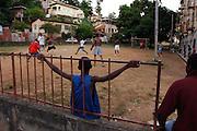 Trinidad & Tobago, Port of Spain, football, soccer, World Cup; The National Football Team, the Soca Warriors, of this tiny nation of 1.3 qualified for the 2006 World Cup in Germany. Football teams are founded everywhere. Members of 'Saints United', coached by Hayden Hutchinson, at practice in front of the 'Spree Simon Flats' in East Dry river, a neighborhood in Port of Spain. Girls may play, but are not accepted on the official team. According to the coach, that is about to change soon..German: Trinidad & Tobago, Port of Spain, Karibik, Fussball, Fussballspieler, Fussballweltmeisterschaft, WM, Die National Mannschaft von T&T, die 'Soca Warriors', hat sich als kleinste Nation fuer die Teilnahme an der WM 2006 qualifiziert. Wo es noch keine Fussball Vereine gab, entstehen sie jetzt. Die Spieler der Jugendmannschaft 'Saints United' trainieren unter Coach Hayden Hutchinson vor einem regulaeren Spiel auf dem Platz vor dem 'Spree Simon Flats' Wohnblock im Stadteil East Dry River. Die Tore sind von den Bewohnern des Wohnblocks aus Bambus Rohren hergestellt worden. Maedchen duerfen mitspielen, sind aber nicht im offizielen Team der Jugendmannschaft zugelassen. Das soll sich bald aendern...