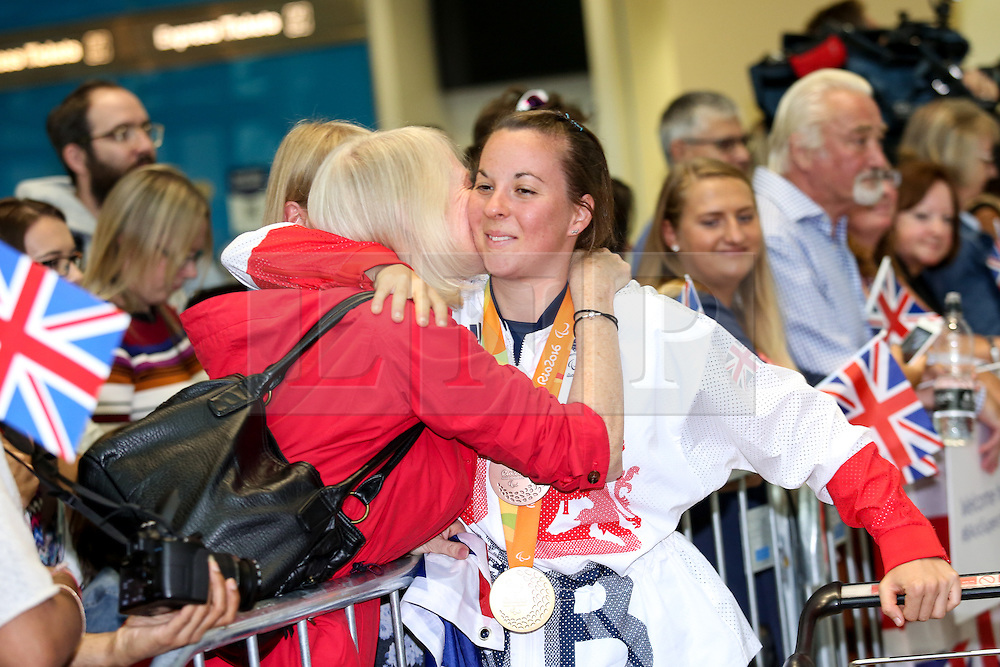 © Licensed to London News Pictures. 20/09/2016. London, UK. Team GB Paralympian Corrine Hall arrives at terminal 5 of London Heathrow Airport after flying on British Airways flight BA2016. Team GB finished second in the Paralympics medals table with 147 medals beating their total of 120 at London 2012. Photo credit : Tom Nicholson/LNP
