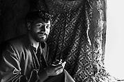 A male refugee inside his home at the IDP Charahi Qambar refugee camp.