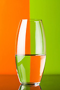 glass vase on color background by Andrea Robles