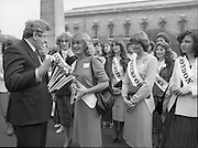 An Taoiseach Meets The Roses Of Tralee.  (N90)..1981..28.08.1981..08.28.1981..28th August 1981..An Taoiseach, Garret Fitzgerald, met with the contestants of The Rose Of Tralee Festival when they were invited to Government Buildings, Leinster House, Dublin...Image shows the Toronto Rose accepting a rose and booklet from An Taoiseach, Garret Fitzgerald as the other Roses look on.
