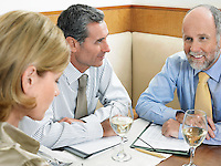 Businesspeople having meeting in restaurant