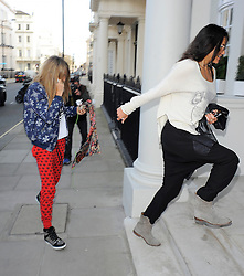 Model Cara Delevingne and girlfriend actress Michelle Rodriguez visit Storm Models management in London, UK. 06/03/2014<br />BYLINE MUST READ : GOTCHAIMAGES.COM<br /><br />Copyright by © Gotcha Images Ltd. All rights reserved.<br />Usage of this image is conditional upon the acceptance <br />of Gotcha Images Ltd, terms and conditions available at<br />www.gotchaimages.com