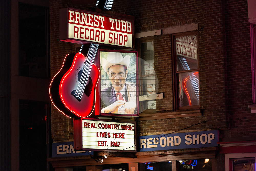 Neon signs for Ernest Tubbs Record Store and other honky-tonks on lower Broadway in Nashville, TN.