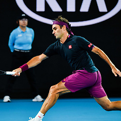 Tennis: open de Melbourne. (200120) -- MELBOURNE, Jan. 20, 2020 (Xinhua) -- Roger Federer of Switzerland hits a return to Steve Johnson of the United States during their men's singles first round match at the Australian Open tennis championship in Melbourne, Australia on Jan. 20, 2020. (Xinhua/Zhu Wei)<br /> <br /> <br /> <br /> 250084 2020-01-20  Melbourne <br /> <br /> Photo by Icon Sport - Roger FEDERER