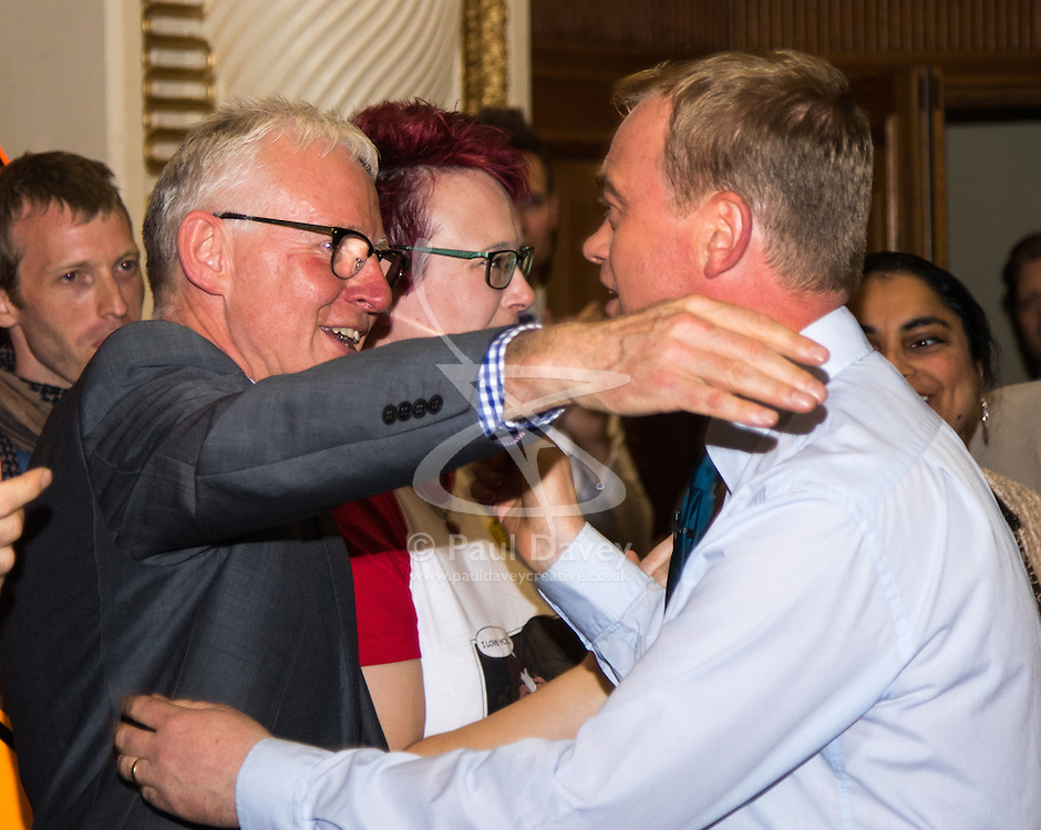 Islington Assembly Hall, London, July 16th 2015. The Liberal Democrats announce their new leader Tim Farron MP who was elected by party members in a vote against Norman Lamb MP. PICTURED: New Liberal Democrat Leader Tim Farron (R) embraces his opponent in the party leadership race, Norman Lamb MP.