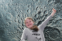 17/07/2018 repro free:  8 year old Ciara O Flaherty from Oranmore with Luke Jerram&rsquo;s Museum of the Moon measuring seven metres in diameter and featuring 120dpi detailed NASA imagery of the lunar surface pictured in  Human Biology Building, NUI Galway as part of Galway International Arts Festival. Museum of the Moon is a new touring artwork by UK artist Luke Jerram who is known worldwide for his large scale public artworks.  The installation is a fusion of lunar imagery, moonlight and surround sound composition created by BAFTA and Ivor Novello award winning composer Dan Jones. GIAF runs from 16 &ndash; 29 July www.giaf.ie<br />   .Photo:Andrew Downes, XPOSURE