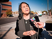 "07 DECEMBER 2010 - PHOENIX, AZ:  DOLORES HUERTA talks to a Spanish language television reporter during a protest in support of the DREAM Act at the offices of US Sen. John McCain in Phoenix Tuesday. Huerta, who started working in the civil rights movement in the 1960's, threw her support behind students fasting on behalf of the DREAM Act in front of Sen. John McCain's office Tuesday. The student picked McCain's office because he used to support the DREAM Act. They hope that the US Senate will pass the DREAM Act during its ""lame duck"" session. The Senate debated and defeated similar legislation just before the November general election. PHOTO BY JACK KURTZ"