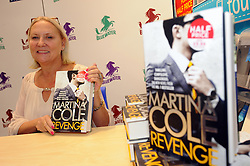 "© Licensed to London News Pictures. 26/10/2013<br /> Crime writer Martina Cole at W H Smiths in Bluewater Shopping Complex, Kent (today 26.10.2013) signing copies of her book ""Revenge""<br /> Photo credit :Grant Falvey/LNP"