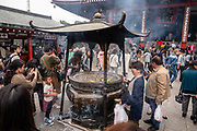 Incense (osenko) is burned for healing power at Japanese temples. Founded in 645 AD, the popular Buddhist temple Sensoji (or Asakusa Kannon Temple) was completely rebuilt several times, mostly after World War II, in Asakusa, Tokyo, Japan.