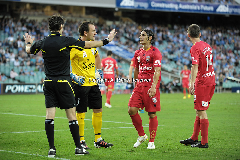 22.12.2011 Sydney, Australia.The Adelaide players disagree with the referees decision for a penalty during the A-League game between Sydney FC and Adelaide United played at the Sydney Football Stadium.