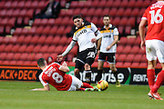 Port Vale midfielder Anthony de Freitas (28) is tackled by Charlton Athletic midfielder Andrew Crofts (8) during the EFL Sky Bet League 1 match between Charlton Athletic and Port Vale at The Valley, London, England on 19 November 2016. Photo by David Charbit.