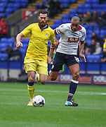 Stuart Dallas and Darren Pratley battle during the Sky Bet Championship match between Bolton Wanderers and Leeds United at the Macron Stadium, Bolton, England on 24 October 2015. Photo by Pete Burns.