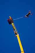 A man doing a bungee jump, Global Gathering festival, Long Marston Airfield, Stoke on Trent, UK. 28/29 July 2006
