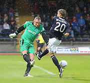 Forfar's Rab Douglas clears as Dundee's Jim McAlister challenges  - Dundee v Forfar Athletic, Ramsdens Cup at Dens Park<br />  <br />  - &copy; David Young - www.davidyoungphoto.co.uk - email: davidyoungphoto@gmail.com