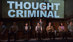 "© Licensed to London News Pictures. 08/05/2014. London, England. Pictured: Cast with Sam Crane as Winston (grey waistcoat) and Tim Dutton as O'Brien (standing) during the Two Minutes Hate. The Play ""1984"" by George Orwell transfers to the Playhouse Theatre until 19 July 2014. A new adaptation for the stage by Robert Icke and Duncan MacMillan. With Sam Crane as Winston Smith. Photo credit: Bettina Strenske/LNP"