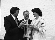 """The Carlingford Oyster Festival.1982.19.08.1982..08.19.1982.19th August 1982..Pictures and Images of the Carlingford Oyster Festival... The Minister For Fisheries and Forestry Mr Brendan Daly officially opened  The Carlingford Oyster Festival. The Chairman of the organising committee was Mr. Joe McKevitt..""""The Oyster Pearl"""" was Ms Deirdre McGrath..The Minister is encouraged to try an oyster himself."""