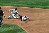 Ben Revere (11) of the Minnesota Twins is tagged out by Jhonny Peralta (27) of the Detroit Tigers while trying to steal 2nd base on August 15, 2012 at Target Field in Minneapolis, Minnesota.  The Tigers defeated the Twins 5 to 1.  Photo: Ben Krause