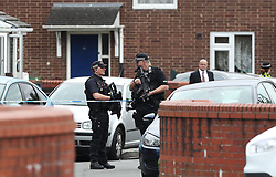 RETRANSMITTING CORRECTING TO QUANTOCK STREET FROM QUANTOCK CLOSE<br /> Armed police at a cordon in Quantock Street, Moss Side, as fresh arrests and raids are carried out in Manchester linked to Monday's suicide bombing.