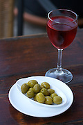Platja de Son Baulo?. Es Moli? restaurant. Olives and red wine.