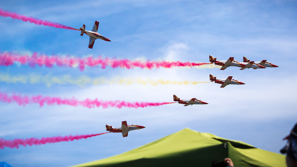 The Patrulla Águila of the Spanish Airforce perform aerobatic stunts for the crowds at the 2017 Moto GP at the Circuito de Jerez.