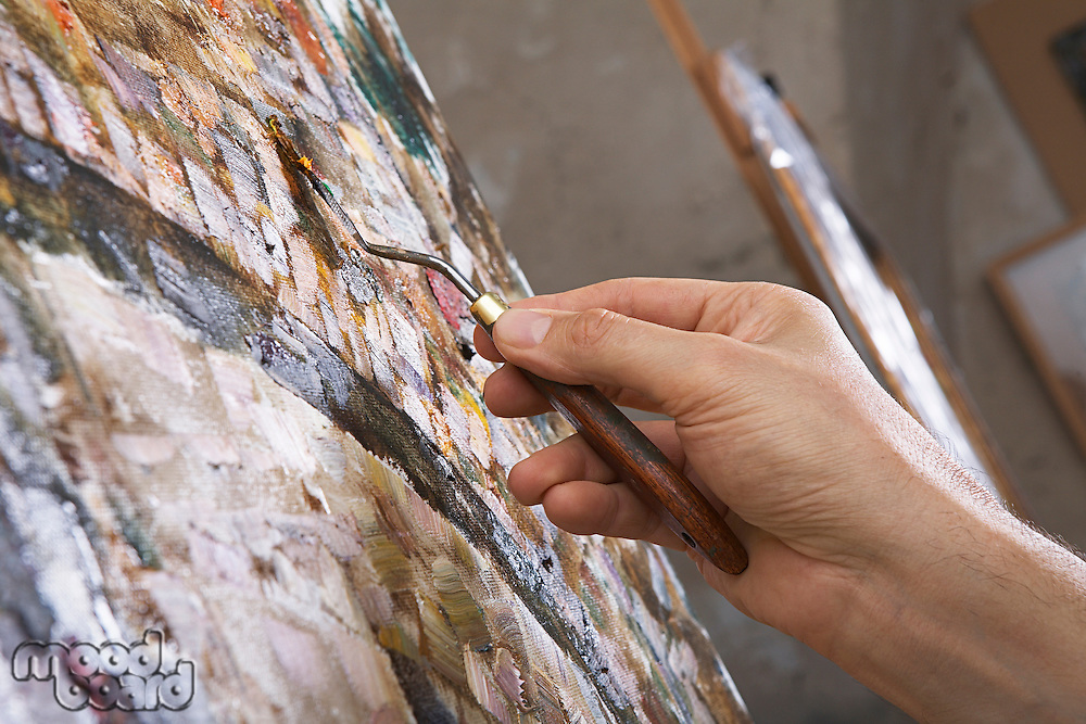 Artist Painting With Palette Knife