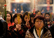 People pray with incense at the Thien Hau temple to celebrate the first day of the Chinese Lunar New Year, the Year of the Dog, on Friday February 16, 2018, in Los Angeles, the United States. (Xinhua/Zhao Hanrong)<br /> 2月16日,农历正月初一凌晨,在美国洛杉矶,大批华人涌入中国城天后宫庙上香祈福。图为民众在庙內参拜。新华社发 (赵汉荣摄) (Photo by Ringo Chiu)<br /> <br /> Usage Notes: This content is intended for editorial use only. For other uses, additional clearances may be required.
