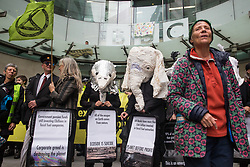London, UK. 11 October, 2019. Climate activists from Extinction Rebellion dressed as creatures facing extinction assist in the blocking of the main entrance to the BBC's New Broadcasting House on the fifth day of International Rebellion protests. The activists were demanding that the broadcaster 'tell the truth' regarding the climate emergency.
